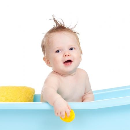 baby bath: adorable infant having bath in blue tub