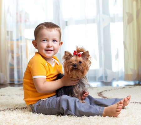 kid hugging puppy indoor photo