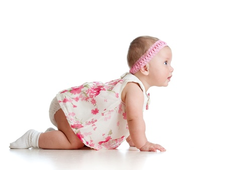 crawling baby: side view of pretty crawling baby