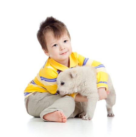 happy kid playing and hugging puppy dog photo