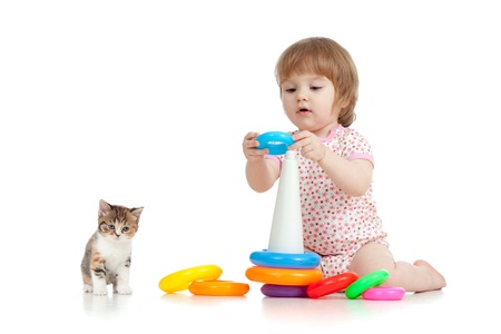pretty little child or kid playing with color toy photo