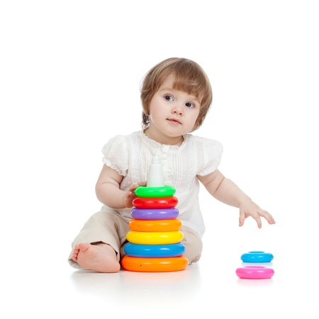 cute kid girl playing with toy photo