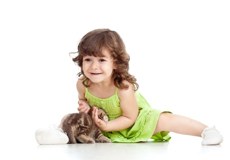 british pussy: funny happy child playing with cat kitten Stock Photo