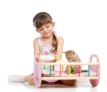 baby  pussy: child girl feeding and playing kitten cat