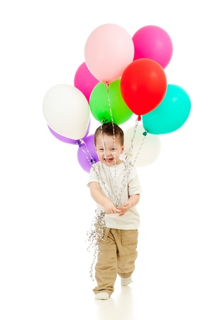 Jolly funny child boy with bunch of colorful ballons in his hands  Isolated on white  photo