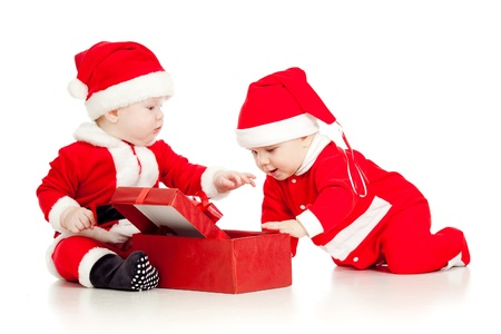 Christmas funny small kids in Santa Claus clothes with gift box Stock Photo - 14726713