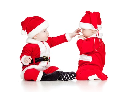 Christmas funny small kids in Santa Claus clothes isolated on white background Stock Photo - 14726732