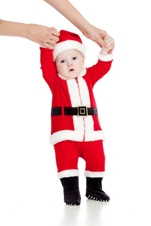 first steps of child dressed as Christmas Santa claus Stock Photo - 14726725