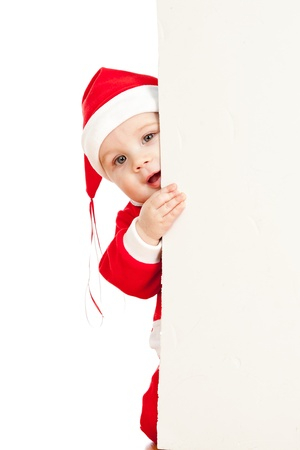 small Santa claus child looking from behind the placard Stock Photo - 14726716