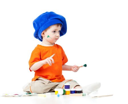 small artist kid with paints and brush photo