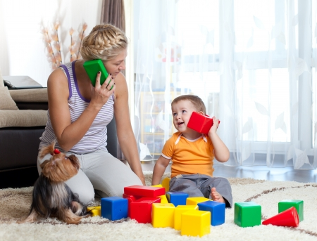 mother and kid boy role-playing together indoor photo