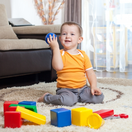 building activity: Child playing with building blocks at home