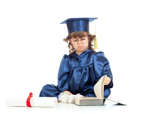 Little girl child in academician clothes  reading book photo