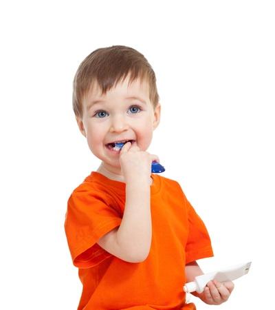 cute child brushing tooth isolated on white background photo