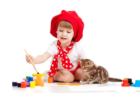small artist child painting with kitten photo