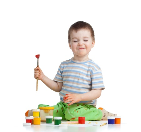 happy child boy with paints photo