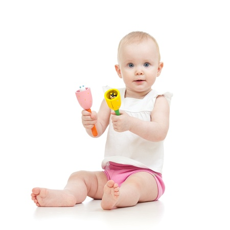 Baby girl with musical toys  Isolated on white background photo