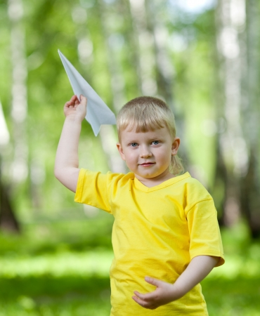 children playing together: Children playing and flying a paper airplane