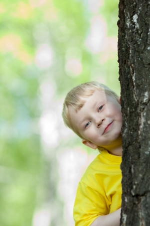 kid playing on the park tree outdoor photo