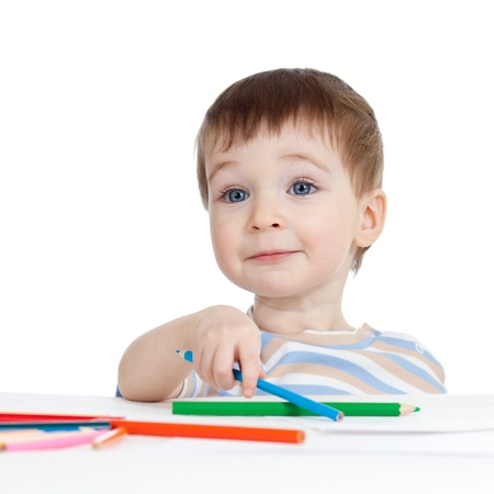 funny child boy drawing with color pencils photo
