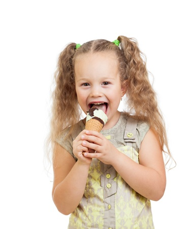 little curly girl eating ice cream in studio isolated photo