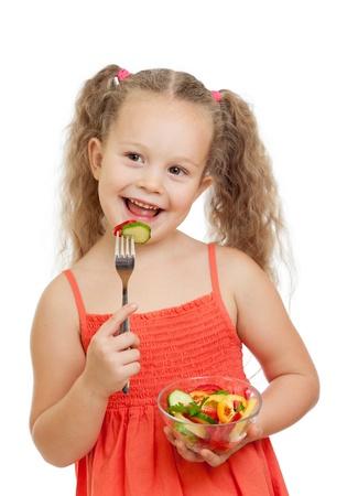 chica ni�o comiendo verduras con alimentos saludables Foto de archivo - 15036348