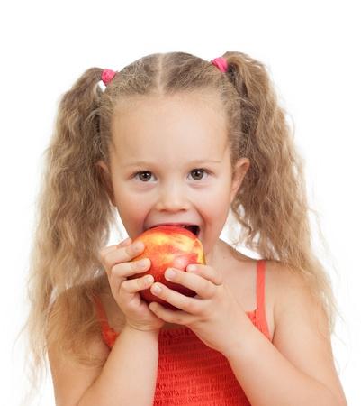 enfant mangeant des pommes aliments sains Banque d'images