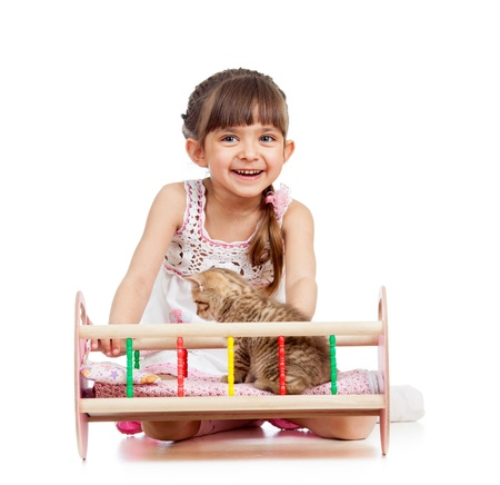 curly kid girl playing with kittens photo