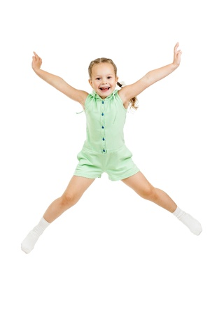 happy child girl jumping isolated on white photo