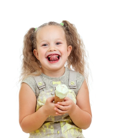 funny little curly girl eating ice cream in studio isolated