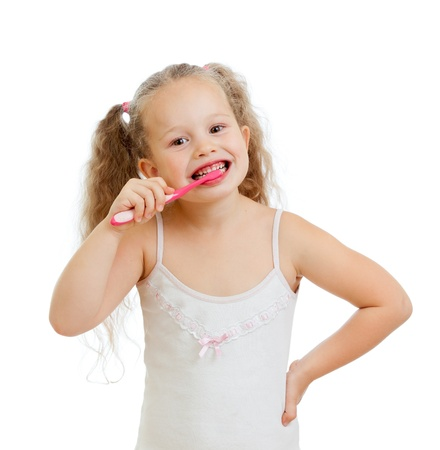 routines: cute kid girl brushing teeth isolated on white background Stock Photo