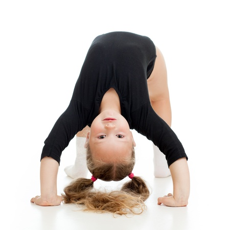 floor standing: young girl doing gymnastics over white background
