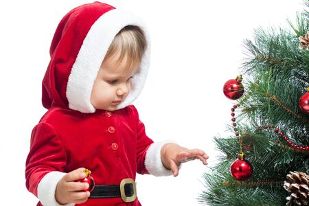 pretty Santa Claus baby decorating Christmas tree isolated on white Stock Photo - 15144675