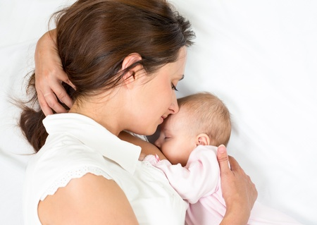 breasts girl: happy mother breast feeding her baby infant