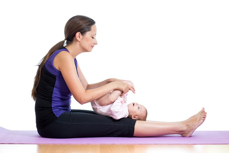 Mother doing yoga exercises with her baby Stock Photo - 15144611