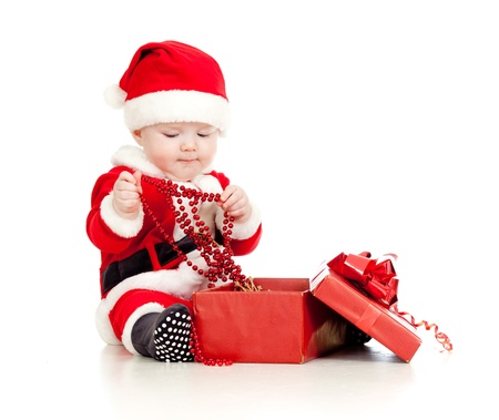 santa hand: Santa Claus baby with gift box isolated on white background Stock Photo
