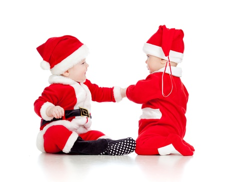 two funny small kids in Santa Claus clothes isolated on white background photo