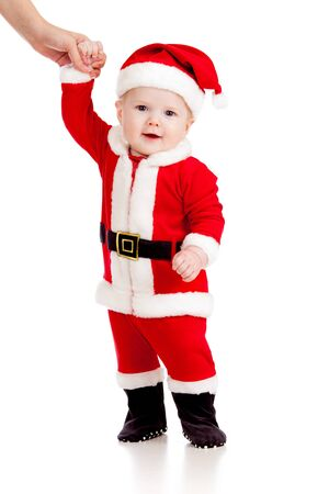 first steps of cute baby dressed as Santa claus Stock Photo - 15229442
