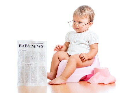 baby wardrobe: funny child girl reading newspaper on chamberpot