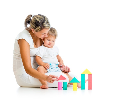 children playing with toys: mother and baby playing with building blocks toy isolated on white