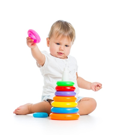 cute kid girl playing with educational toy isolated on white photo