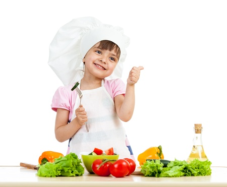 upbringing: Chef girl preparing healthy food and showing thumb up over white background Stock Photo