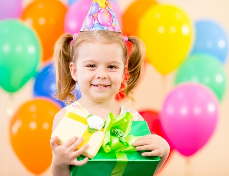 pretty girl  with colorful balloons and gifts on birthday party Stock Photo - 15478111