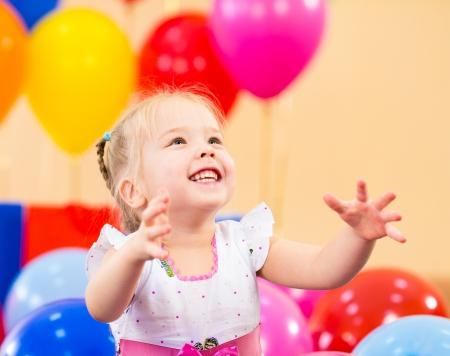 kids birthday party: joyful kid girl on birthday party