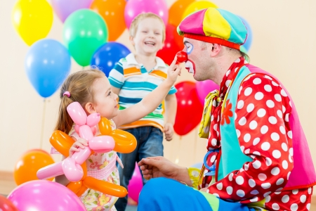 ballons: happy children and clown on birthday party