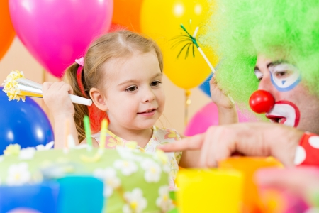happy child girl with clown on birthday party Stock Photo - 15478110