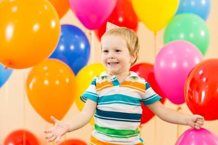 ballons: joyful kid boy on birthday party Stock Photo