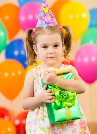 Cute girl  with colorful balloons and gifts Stock Photo - 15584099