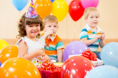 pretty girl  with colorful balloons and gifts on birthday party photo