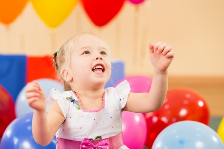 joyful kid girl on birthday party photo